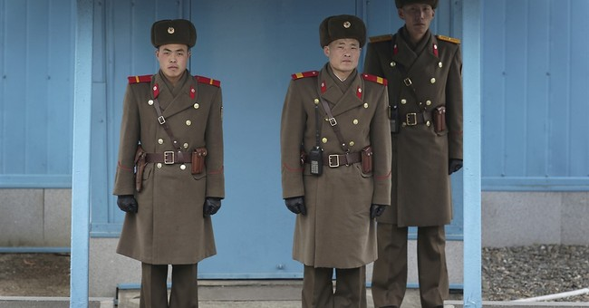N. Korea, on defense after sanctions, makes nuclear threat