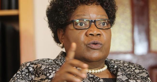 Former Zimbabwean VP criticizes Mugabe and his wife
