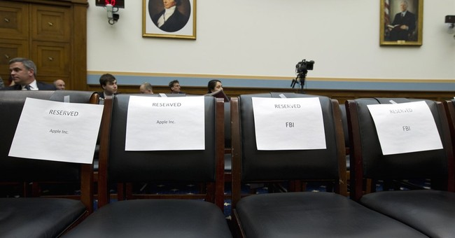 Apple, FBI stake out conflicting positions before Congress