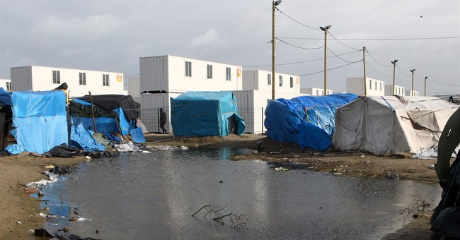 Iranian migrants sew mouths shut in French camp protest