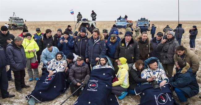 Yearlong spacemen embrace fresh, frigid air back on Earth