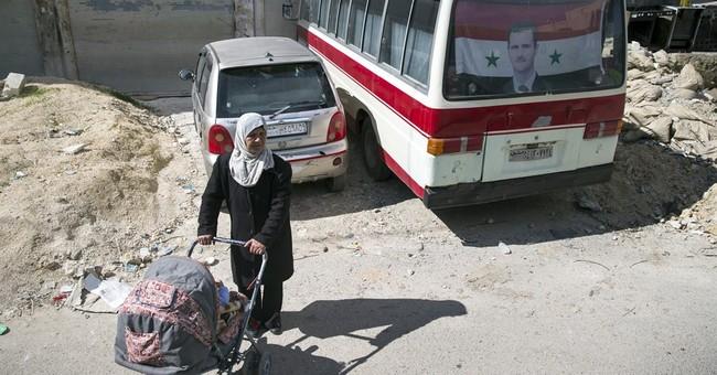 The Latest: Damascus official warns Turkey, Saudi Arabia