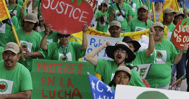 The Latest: Farmworkers announce boycott against Wendy's
