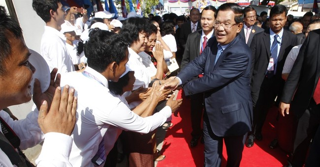 Cambodia leaders rev up Facebook rivalry as popularity soars
