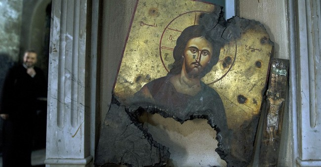 Christian hamlet in Syria bears scars of fierce fighting