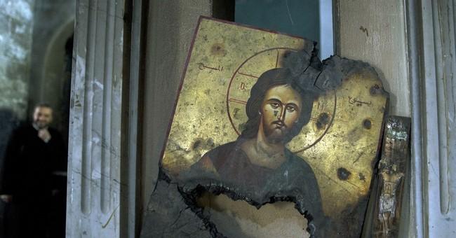 Christian hamlet in Syria bears scars of fierce fighting