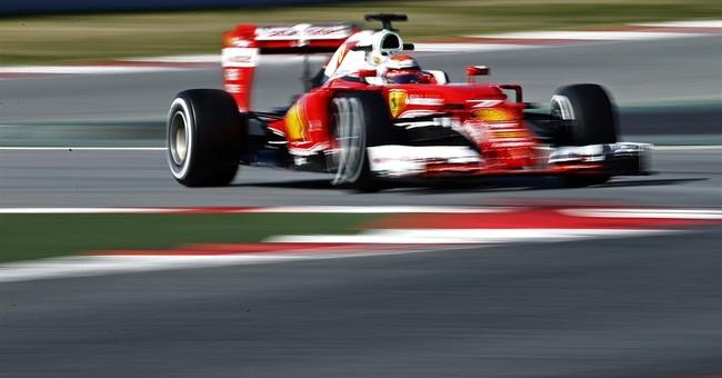 Ferrari driver Kimi Raikkonen tries out halo in F1 testing