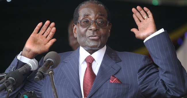 """Zimbabwe's Mugabe: """"Do you want me to punch you"""""""