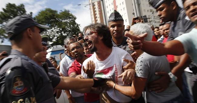 Police question Brazil's ex-president in corruption probe