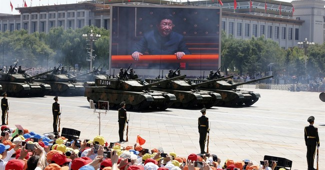The Latest: Delegates praise Chinese leaders' economic plans