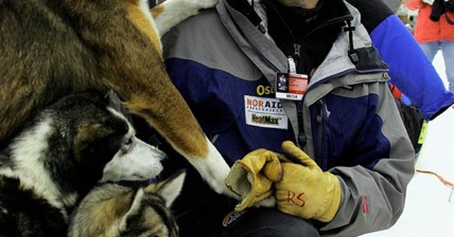 The Latest: Lack of snow doesn't hinder Iditarod start