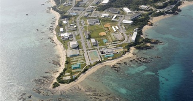 Japan PM suspends work on US base on Okinawa, agrees to talk