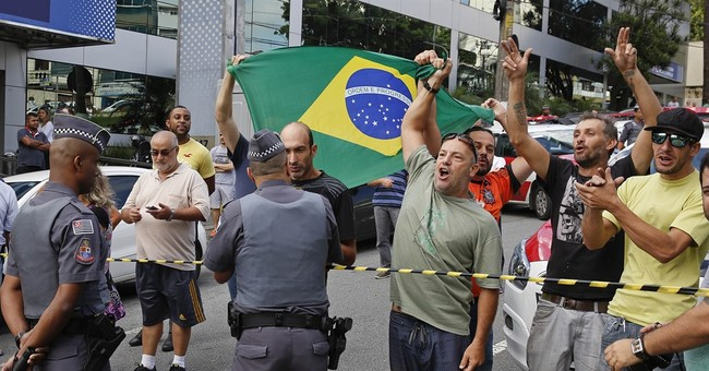 Crowds cheer Brazil's Silva after being grilled by police