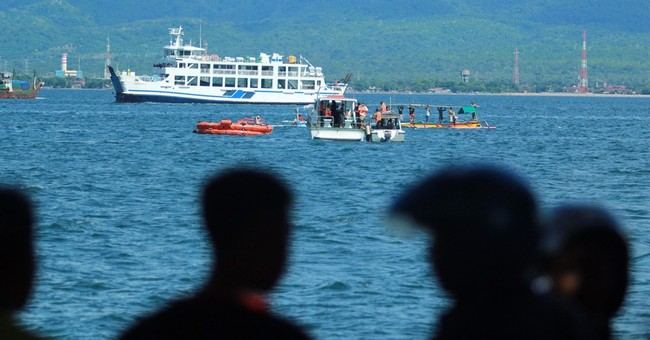 Passengers jump into sea as ferry sinks in Indonesian strait