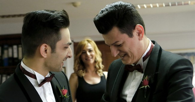 Cyprus' first public gay wedding takes aim at prejudices