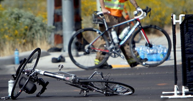 Truck slams into group of bicyclists at red light, killing 2