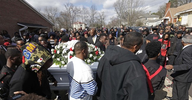 Hundreds pack funeral for black man shot by Raleigh officer
