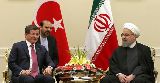 Turkish PM visits Iran despite differences on Syria