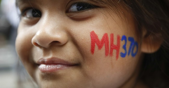 Families of missing Flight 370 press for search to continue