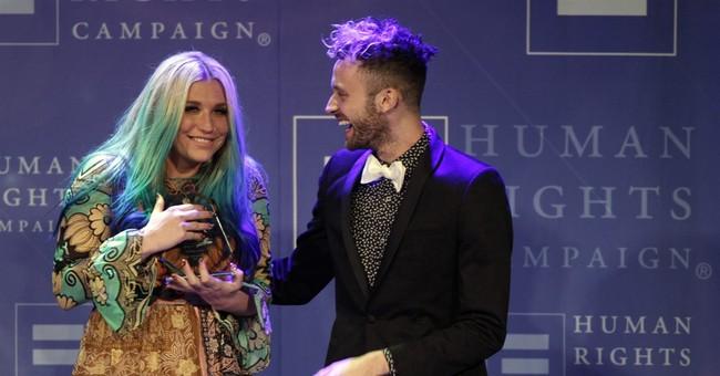 Kesha chokes up at award dinner, thanks supporters