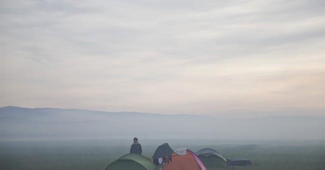 EU looks to refugee-laden Turkey to ease its migrant burden