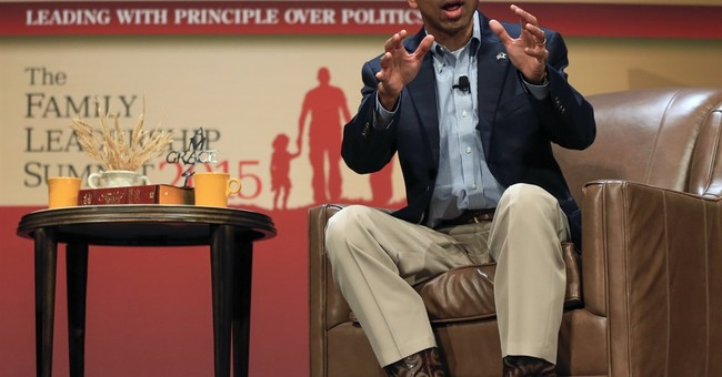 Out of office, Jindal looms over Louisiana budget crisis