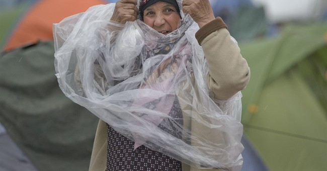 The Latest: Minister: Greece can provide shelter for 70,000