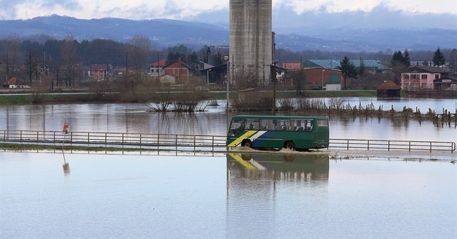 Rain-swollen rivers flood houses, roads in central Serbia