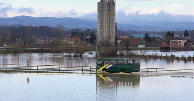 Rain-swollen rivers flood houses, roads in central Serbia