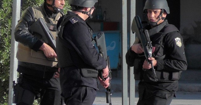 The Latest: Tunisia premier says IS responsible for attack