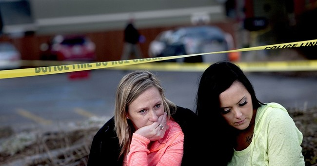 Motive unknown in Idaho church shooting, search continues