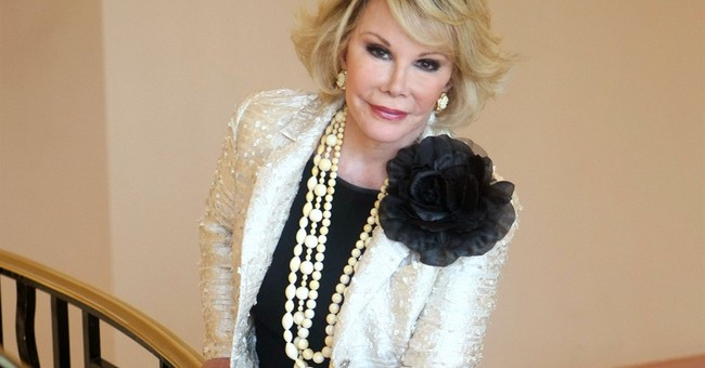 Joan Rivers' art, jewelry, designer gowns hit auction block
