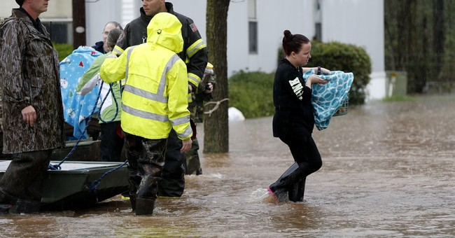 Storm dumps rain over South, sparks flooding, evacuations
