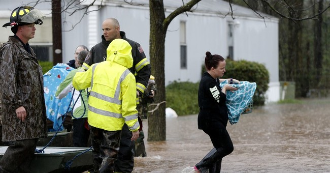 Storm dumps rain over South, sparks flooding, evacuations