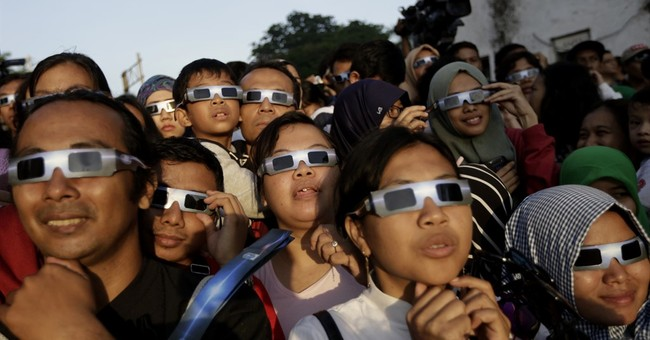Prayers, cheers as total eclipse darkens swath of Asia