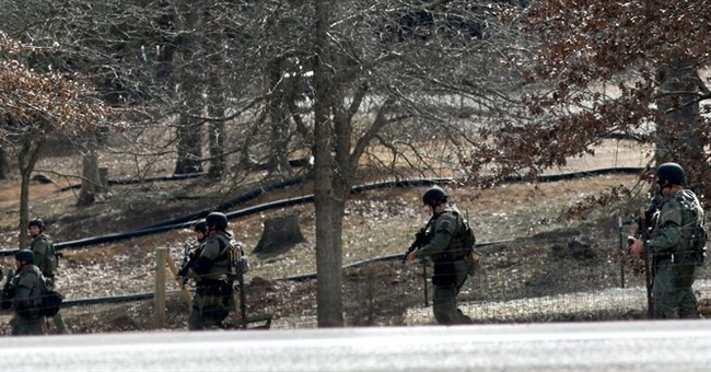 The Latest: Missouri slaying victim's family seeks answers
