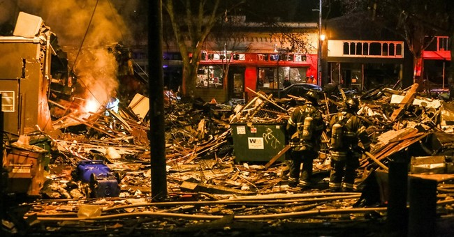 The Latest: Surveillance video shows force of Seattle blast