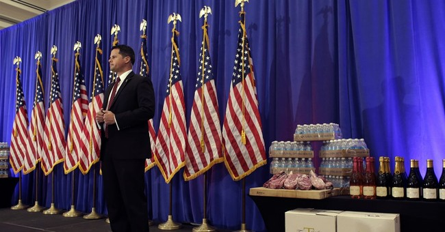 Trump displays steak, water, wine to defend business record