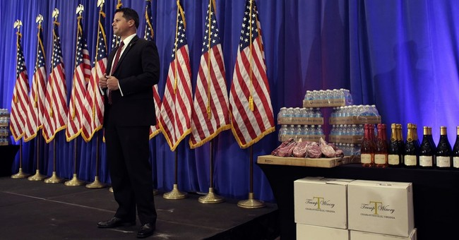Trump displays steak, water, wine to defend business record