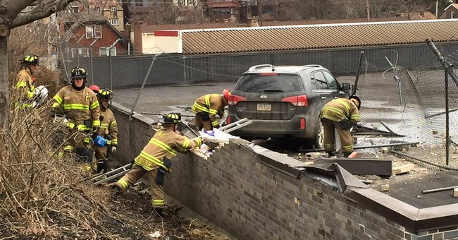 SUV drives off road, lands on roof of Pittsburgh supermarket