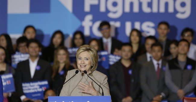 Clinton portrays Sanders as at odds with Obama on guns