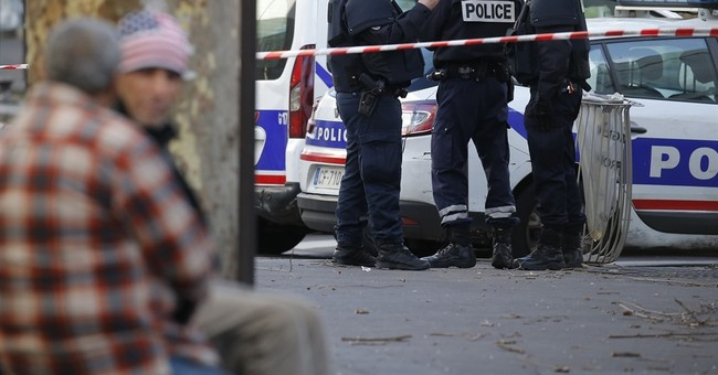 Police try to determine identity of Paris police attacker
