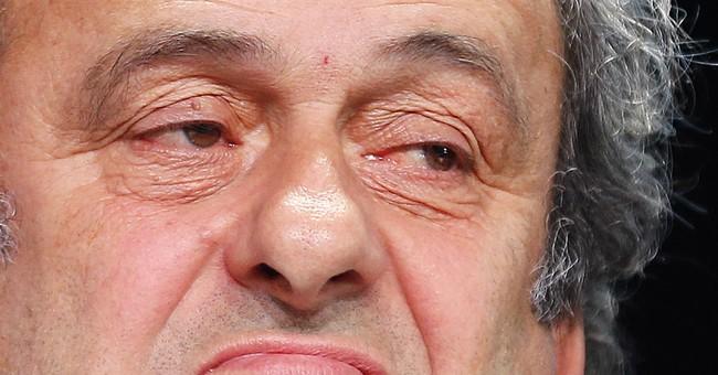 APNewsbreak: Platini withdraws from FIFA presidential race