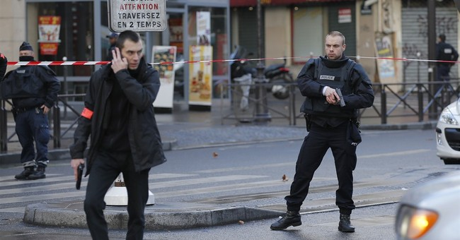 The Latest: Initial probes identify man in Paris shooting
