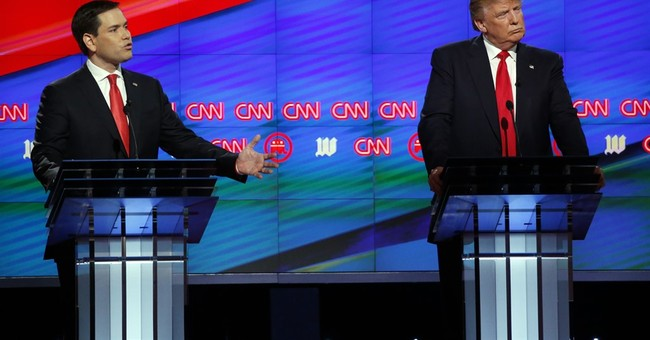 Trump, GOP rivals fight on _ but politely _  in late debate