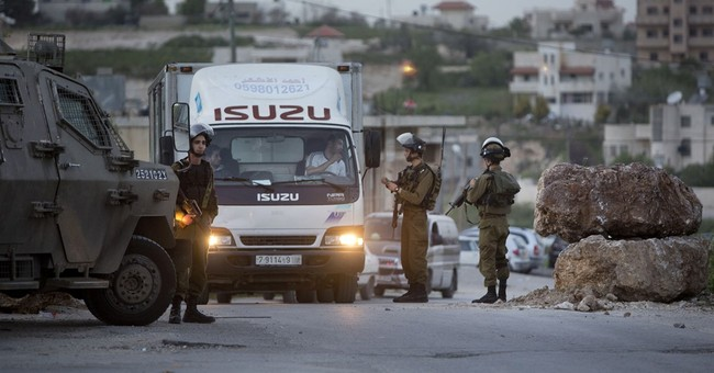 Israel looking into police shooting of Palestinian attacker