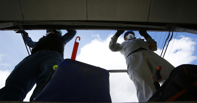 Fukushima 'decontamination troops' often exploited, shunned