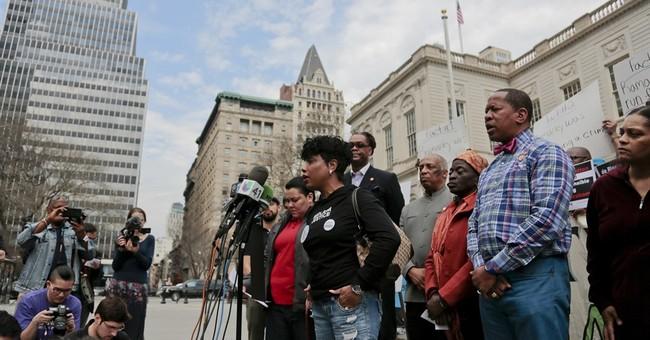 Family seeks firing of white NYC cop who killed black teen