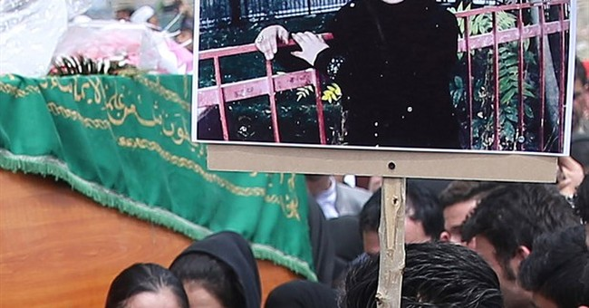 Afghan president reopens case of woman lynched by mob