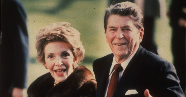 The Latest: Obama criticized for missing Reagan funeral